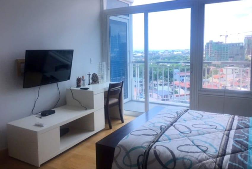 2-bedroom-in-1016-residences-for-rent-bedroom-tv